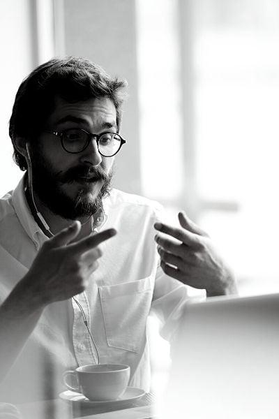 Man Talking Laptop Vertical